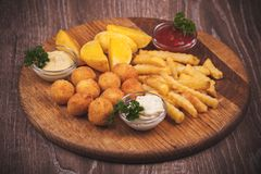 Fried potato platter with dips Royalty Free Stock Photo