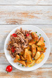 Fried potato and portion of pulled slow-cooked meat royalty free stock photo