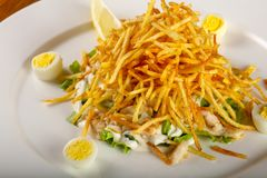 Fried potato salad. With chicken stock image
