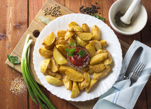 Fried potato slices. A composition of fried potatoes, sauce and parsley Royalty Free Stock Photos