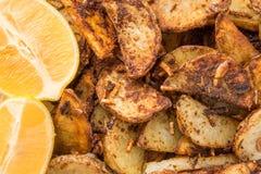 Fried Potato Slices & lemons Royalty Free Stock Photography