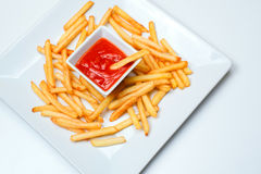 Fried Potato with tomato on white background. French fries with ketchup on a white plate Stock Photography