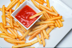 Fried Potato with tomato on white background. French fries with ketchup on a white plate Stock Images