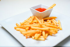 Fried Potato with tomato on white background. French fries with ketchup on a white plate Royalty Free Stock Photography