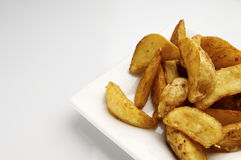 Fried potato wedges Stock Images