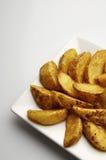 Fried potato wedges Royalty Free Stock Photos