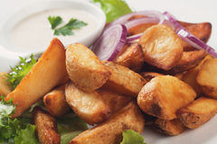 Fried potato wedges. With white sauce and lettuce Stock Photography