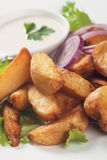 Fried potato wedges. With white sauce and lettuce Royalty Free Stock Photography
