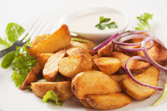 Fried potato wedges Stock Photos