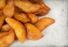 Fried potato wedges Royalty Free Stock Photo