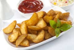 Fried potato wedges with coleslaw & ketchup with basil leaf Stock Images