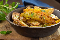 Fried potato. Wedges with herbs Royalty Free Stock Image