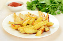 Fried potato wedges Stock Photo