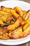 Fried potato wedges on white plate Stock Photography