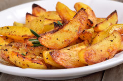 Fried potato wedges on white plate Royalty Free Stock Image