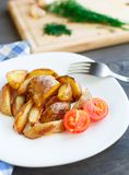 Fried Potato Wedges With Cherry Tomato Royalty Free Stock Photography