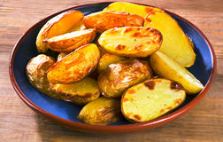 Fried potato on a wooden table Royalty Free Stock Image