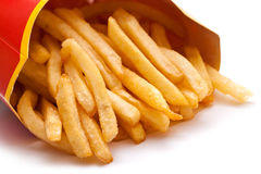 Fried potatoes. In a red box on white background closeup Royalty Free Stock Photos