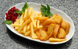 Fried potatoes Stock Photos