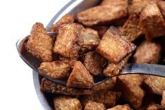 Fried potatoes. Isolated on white background Royalty Free Stock Photo