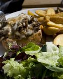 Fried potatoes. A plate of delicious steak sandwich and salad with potatoes Stock Photo
