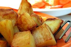 Fried potatoes. On the plate isolated on white background Stock Photo