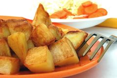 Fried potatoes. On the plate isolated on white background Stock Photos