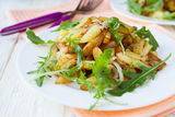 Fried potatoes with arugula. Food royalty free stock photos