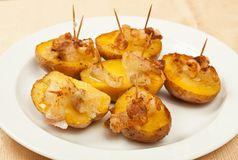 Fried potatoes with bacon Stock Images