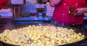 Fried potatoes with bacon - traditional german dish on Christmas market Stock Photography