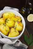 Fried potatoes, bay leaf and olive oil Stock Photos
