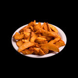 Fried potatoes on black. Background still life Royalty Free Stock Photo