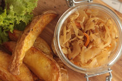 Fried potatoes. With cabbage salad Stock Image