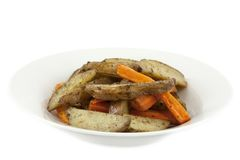 Fried potatoes and carrots Stock Images