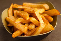 Fried Potatoes. In ceramic bowl salted, closeup detailed view Royalty Free Stock Images