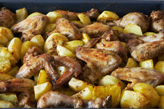 Fried potatoes and chicken Stock Photo