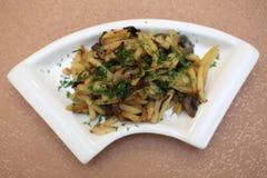 Fried Potatoes con las setas Imagenes de archivo