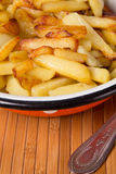 Fried potatoes Stock Photos
