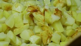 Fried potatoes with a cruise plan. Fried potatoes with a crispy crust stock video