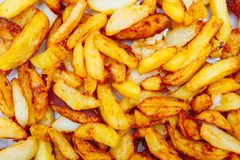 Fried potatoes cut into strips. Yellow texture stock photo
