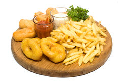 Fried potatoes, deep fried squid and sauce Stock Image