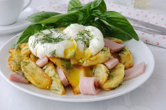 Fried potatoes with dill and ham with egg Stock Image