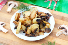 Fried potatoes with  edible fungus Stock Image