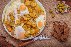 Fried potatoes with egg Royalty Free Stock Photos
