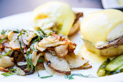 Fried Potatoes and Eggs Benedict Stock Photos