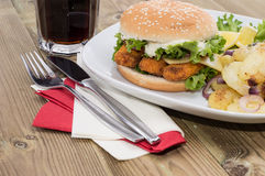 Fried Potatoes with Fish Burger Stock Photo