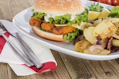 Fried Potatoes with Fish Burger Royalty Free Stock Photography