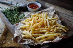 Fried potatoes, french fries, fast food set. Delicious homemade fried potatoes on rustic wooden table. Fast food set, unhealthy eating concept. french fries Royalty Free Stock Image