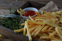 Fried potatoes, french fries, fast food set. Delicious homemade fried potatoes on rustic wooden table. Fast food set, unhealthy eating concept. french fries Royalty Free Stock Photos