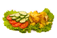 Fried potatoes with fresh cucumbers and tomatoes Royalty Free Stock Photos